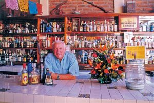 John Bragg behind the bar at Pancho's in Cabo San Lucas