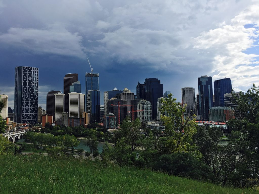 "A panoramic view of downtown Calgary with ""The Bow"" prominently featured on the far left."